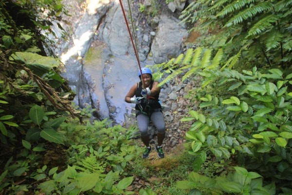 Rappeling down a waterfall